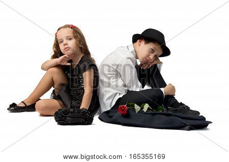 romantic quarrel between young children. boy and girl turned away to each other