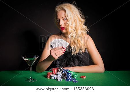 Woman with poker face playing poker game
