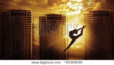 High Rise Building and Sport Woman Dancing Jump Girl Dancer Silhouette over Apartments House in Sun Light