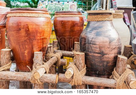 Earthen jars for sale. Crockery made of clay. Pitchers and pots made by hand