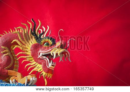 celebrate Chinese New Year background with big dragon statue concept of the Year of the Dragon.