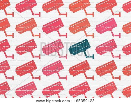Privacy concept: rows of Painted red cctv camera icons around blue cctv camera icon on White Brick wall background