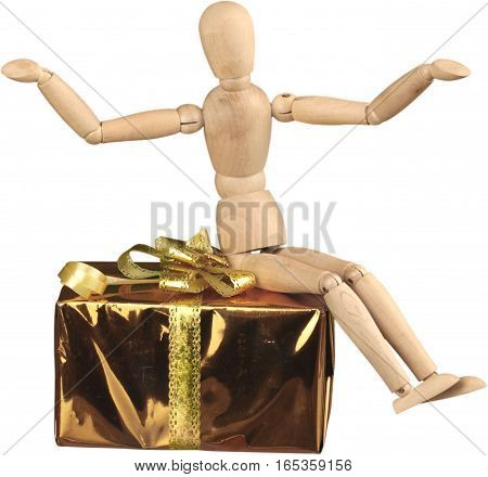 Miniature wooden mannequin sitting on a gift box