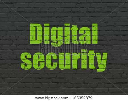 Protection concept: Painted green text Digital Security on Black Brick wall background
