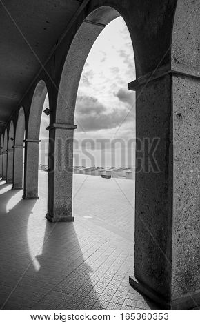 Arches over a hallway by the beach in France