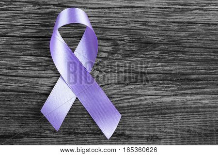 health symbol lavender ribbon on wooden board background.