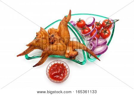 smoked chicken wings and cherry tomatoes on a white background. horizontal foto - top view.