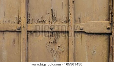 Brown damaged and scratched old door background
