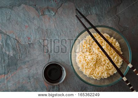 Soup Ramen noodles in glass bowl and wooden sticks horizontal