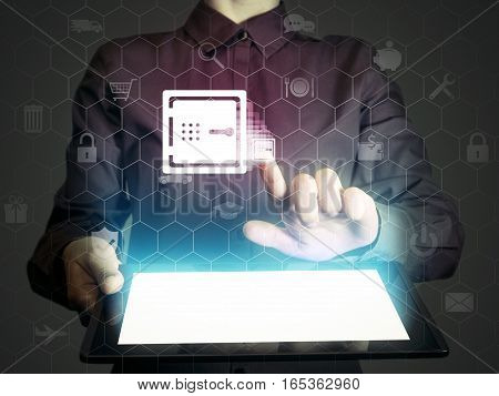 Image of a girl with a tablet in hands. She touches safe icon. Concept of online banking online security protection digital safe money.
