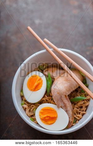 Soup Ramen noodle with chicken wing and bamboo sticks vertical
