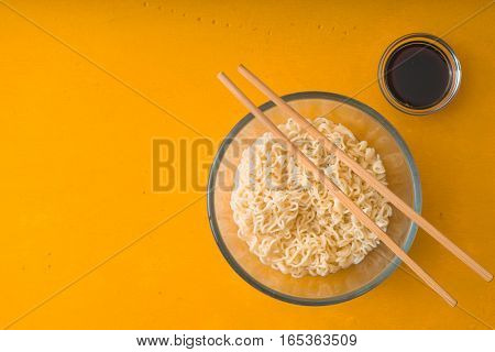 Soup Ramen noodles in glass bowl and soy sause horizontal