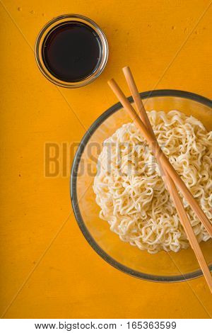Soup Ramen noodles in bowl and soy sause vertical