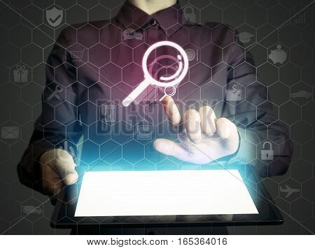 Image of a girl with tablet in her hands and search icon. Сoncept search engine optimization customer support.