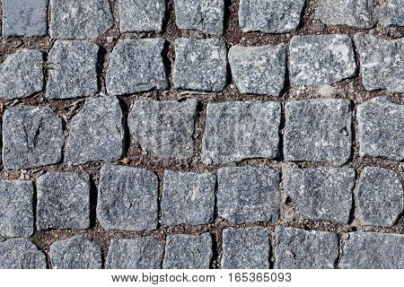 Paving stone macro view photo. Vintage roadway granite blocks pattern.