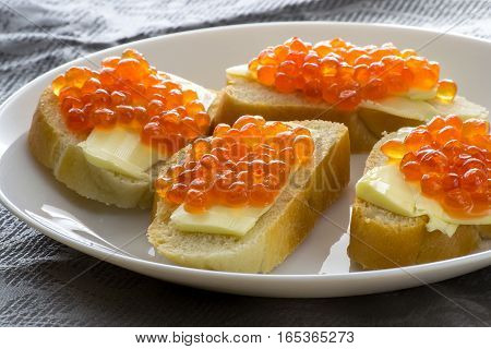 Red caviar with butter and baked bread. Close-up. Side view