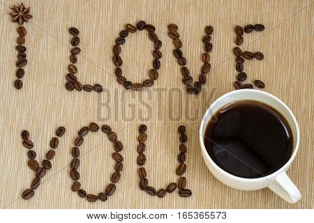 I love you sign with coffee beans and cup of coffee