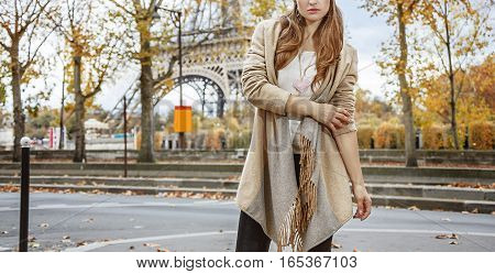 Autumn getaways in Paris. Closeup on young woman in Paris France standing in front of Eiffel tower