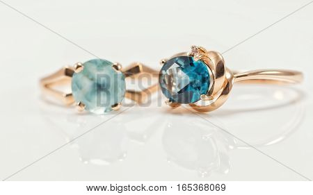 Two Gold Rings With Topazes Of Different Colours