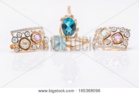 Two Gold Rings With Topaz Stones Of Different Color And Set Of Earrings