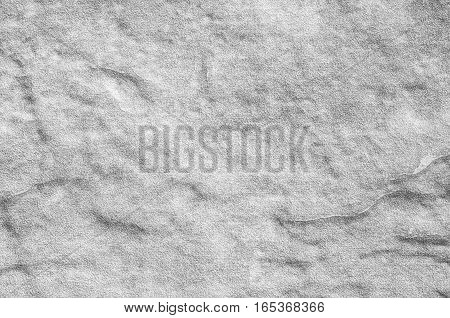 Closeup surface at stone pattern at stone brick wall in the garden textured background in black and white tone