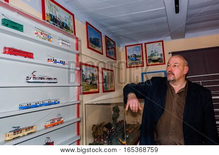 Kolomna, Russia - January 03, 2017: Owner trams-museum shows his collection 1:87 models. Kolomna - the birthplace of the first electric tram in Russia.