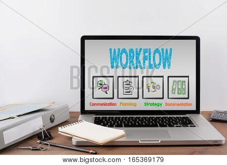 Workflow concept. Wooden office desk with a laptop.