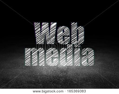 Web design concept: Glowing text Web Media in grunge dark room with Dirty Floor, black background