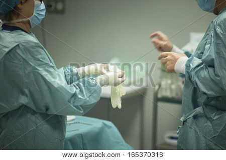 Surgeon Putting On Gloves