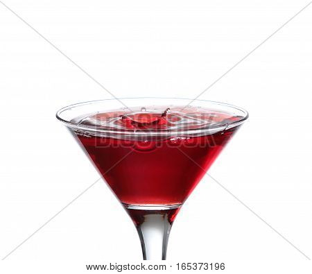 A Martini Glass On A White Background; The Water Ripples And Splashed As A Green Spanish Olive With