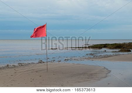 red flag on the beach in Montevideo, Uruguay