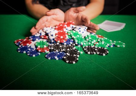 Poker player going all in on poker table