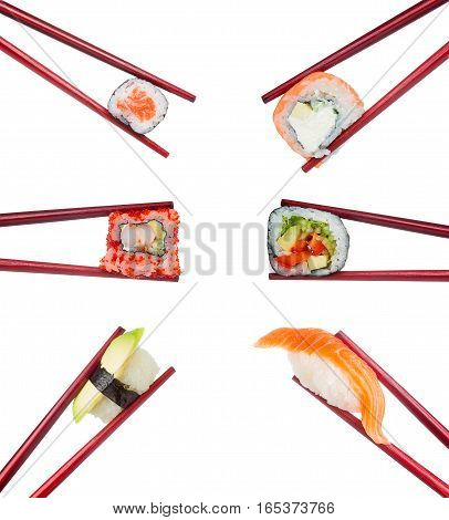 Japanese Cuisine. Sushi Roll And Nigiri Set In Wooden Red Chopsticks Isolated On White Background