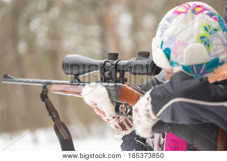 Gomel, Belarus - January 15, 2017: Girl Learns To Shoot From Hunting Rifles With Telescopic Sight.