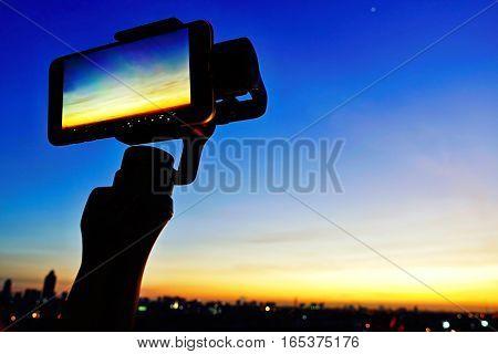 Point focus on smart phones smartphone take photo sunset