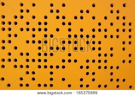Dotted orange background facade. Abstract architectural background.