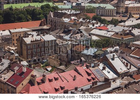 Buildings in a town. Rooftops under sunlight. Townscape during summer.