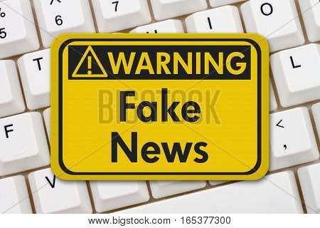 Fake news warning sign A yellow warning sign with text Fake News on a keyboard 3D Illustration