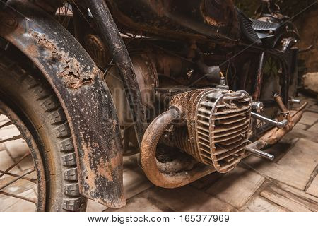 Rusty engine of motorbike. Old black motorcycle. Heart of the machine.