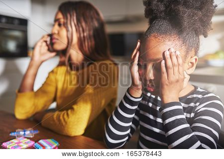 Mother Talking On Phone Forgetting Child
