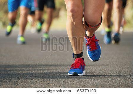 Marathon running race in the light of evening
