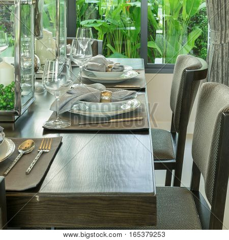 Dinning Room With Table Setting On Wooden Table