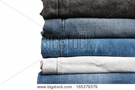 Stack of jeans up-close. Jeans details background with empty space flat view