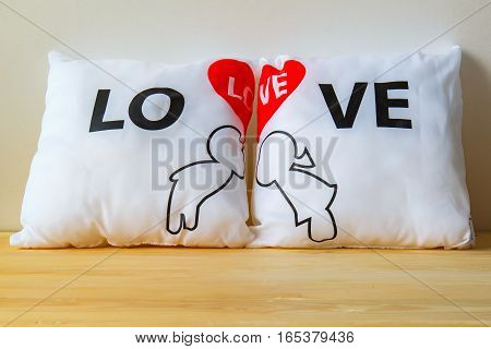 Pillow Love with Valentine's Day on wooden Background