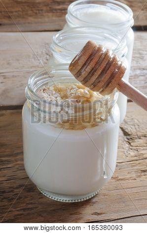 Tasty homemade yogurt with cedar nuts, oatmeal and honey
