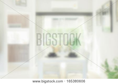 Blurred Background Of White Dining Table In Modern Dining Room