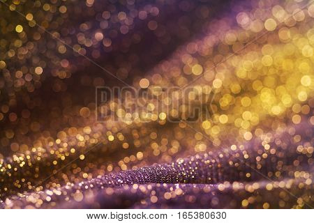 Amazing glitter and glow multi colored bokeh shining. Dark abstract dreamy wunderful sparkle background