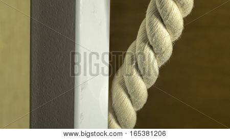 A thick rope and a metal pipe close-up