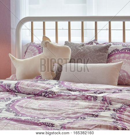 Cozy Bedroom Interior With Puppy Doll And Pink Pillows On Bed