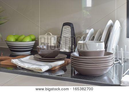 Deep Brown Ceramic Set On Black Granite Top Counter